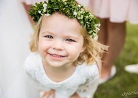 Darling flower girl in her delicate headpiece of boxwood & babiesbreath for this North Dakota/Minnesota border outdoor wedding.