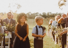 Flower Girl & Ring Bearer framed by the glow of the setting sunlight. The picture of angels at this outdoor Minnetonka Autumn Ceremony