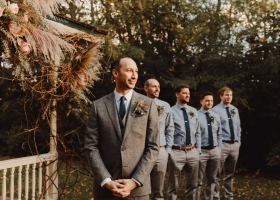 Groom waiting for his lovely bride in his tweed suit and boutonniere filled with texture. and how about the checked blue dress shirts for the Groomsmen? The perfect accessory for this Minnetonka Apple Orchard Autumn Wedding.