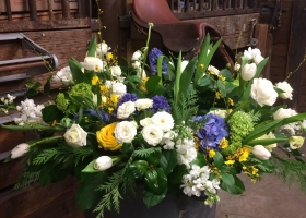 White blue & yellow funeral urn spray