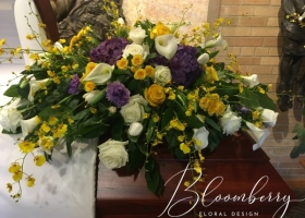 Spring white blue and yellow casket spray