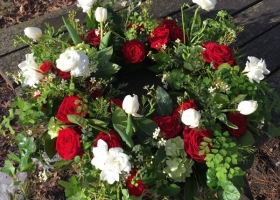 Red and white funeral urn arrangement David Lee Funeral Home