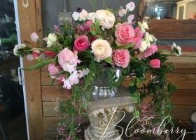 Feminine pink vase arrangement funeral