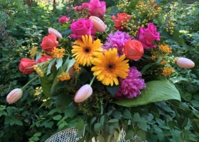 Bright pink and yellow vase arrangement