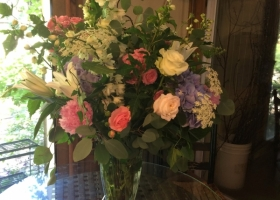 Large garden style family funeral vase arrangement