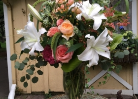 Peach and white Lily Funeral arrangement