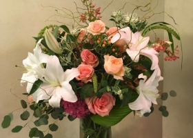 Peach and white rose and lily funeral arrangement