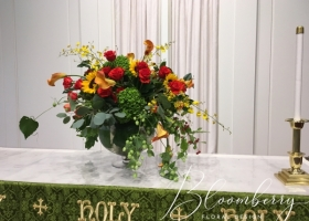 Large family funeral arrangement red and yellow