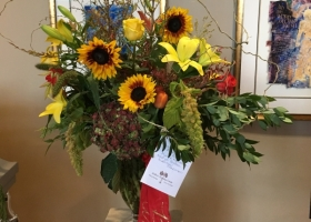 Fall funeral vase arrangement by Kellers Country Estates