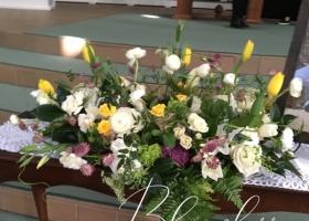 Yellow White and purple Urn Spray Funeral flowers