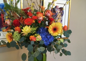 Bright colored spring arrangement funeral Minnesota