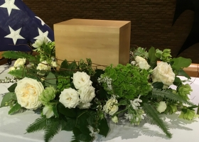 White urn spray patriotic funeral service