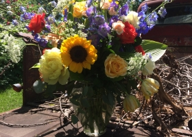 Primary color large vase arrangement funeral service