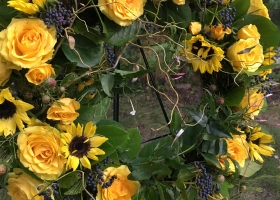 Yellow sunflower funeral wreath spray