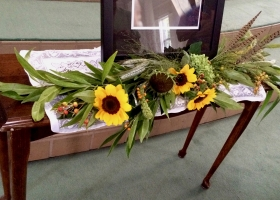 Urn funeral table arrangement woodsy