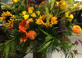 Masculine woodsy yellow orange vase arrangement