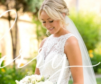 Bride at St Annes Church Hamel Holding bouquet of Peonies, ROses & Ranunculus
