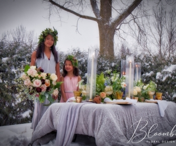 Bride and Flower Girl posing in snow Romantic Florals