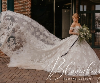 Bride Posing on City Street in Edina outside Annika Bridal