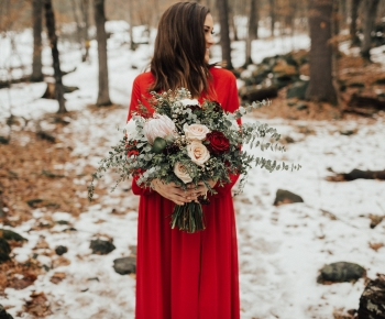 Bride in Red Dress holding Bouquet of White Blush and Merlot Flowers