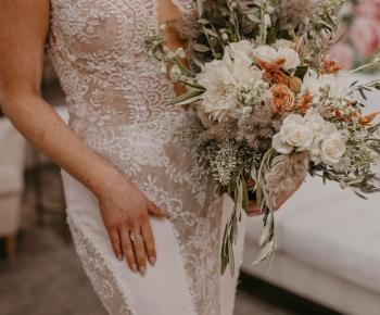 Bride in Designer Wedding Gown Couture Bridal Bouquet