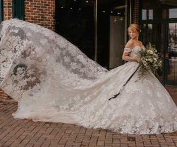 Bride Posing on City Street in Edina outside Annika Bridal
