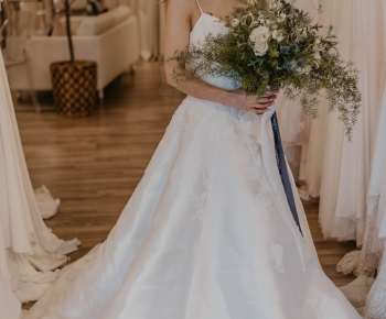 Bride in Designer Wedding Gown Holding Loose Greenery Bouquet