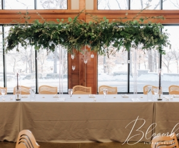 Floating Headtable centerpiece of greenery and candles