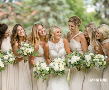 Bride and Bridesmaids with spring floral bouquets at St Annes Hamel