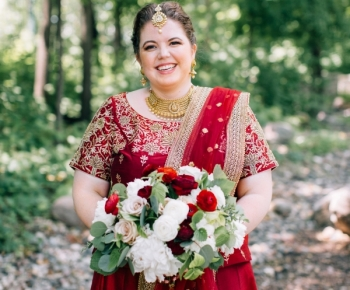 Bride wearing Traditional Indian Gown with Bridal Bouquet by Bloomberry Floral