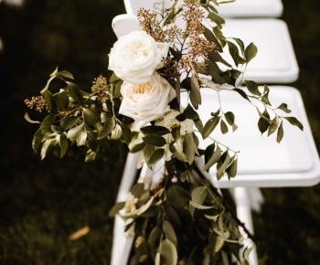Rose and Greenery Pew Arrangement Outdoor Ceremony