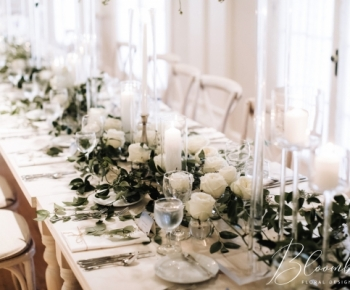 Headtable Harvest Table Candles Greenery and White Flowers