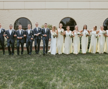 Bridal party with butter yellow and ivory bridal bouquets