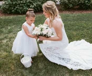 Bride handing flowergirl bouquet made by Bloomberry