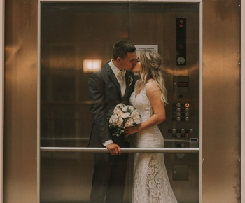 Newly married couple kissing in elevator at the Northland Minneapolis