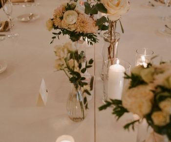 Simple elegant florals at the head table by Bloomberry Floral