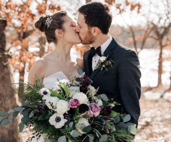 Bride and Groom Kissing Bridal Flowers in White Navy and Purple