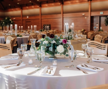 Wedding Receptions Centerpieces in greenery white and purple florals
