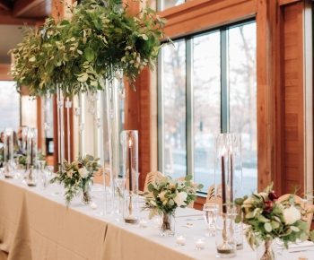 Winter Reception Headtable Centerpiece of Greenery and Candles