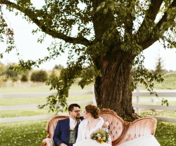 Bride and Groom under tree at The Redeemed Farm