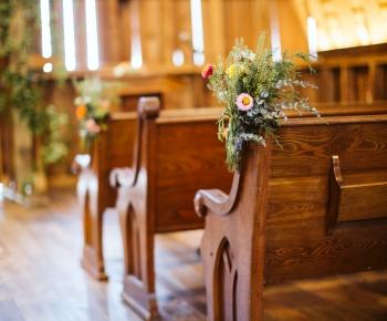 Pew wedding arrangements at Redeemed Farm Minnesota