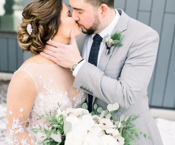 Bride and Groom Kissing Flowers by Anne Monroe