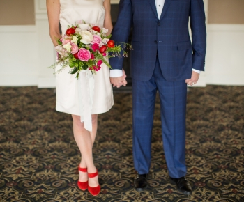 Bride and Groom with red pink and white wedding flowers