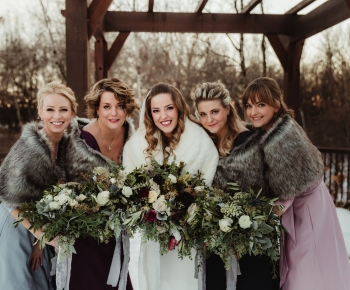 Bride and Bridesmaids wearing fur stoles and Moody Hues Floral Bouquets