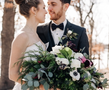 Wedding at Silverwood Three Rivers Park holding Large bridal bouquet
