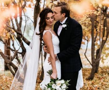 Bride and Groom kissing at Wayzta Country Club wedding