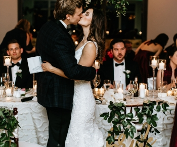 Bride and Groom Kissing Reception at Wayzata Country Club