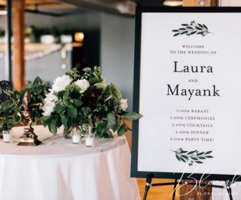 Wedding Guest Entrance Sign and Floral Arrangement at Solar Arts