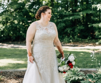 Romantic Bridal Gown - Bride holding moody hue bouquet