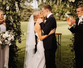 Bride and Groom Kissing Golf Course Wedding Wayzata